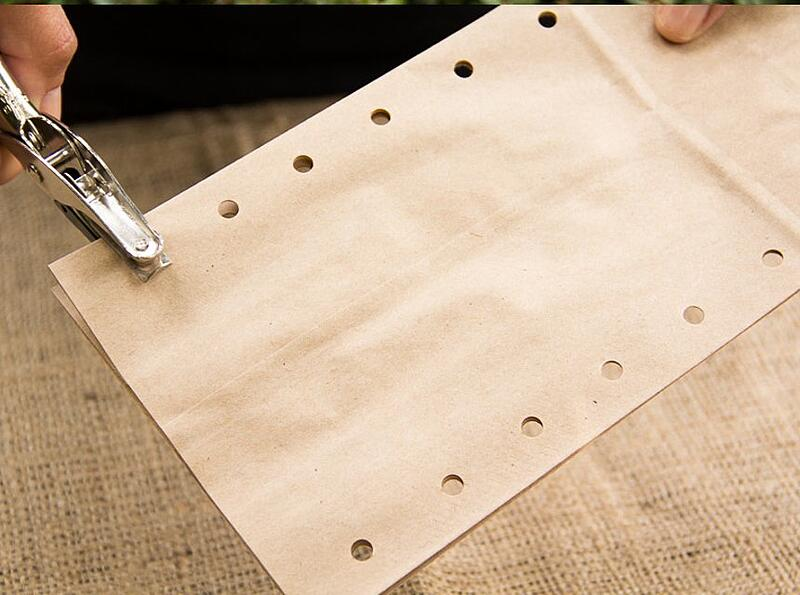 Punching holes in a brown paper bag